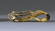 IVORY NETSUKE By Tomokazu. Depicting a thunderfish and gourd with double inlaid eyes. Signed. Length 2.5