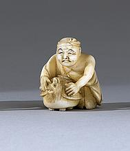 IVORY NETSUKE By Minko. Depicting a man with a badger teapot. Signed. Height 1.25