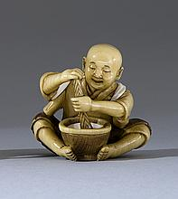 IVORY NETSUKE By Mingyoku. Depicting a child seated with a mortar and pestle. Height 1.5
