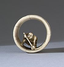 IVORY NETSUKE By Masakazu. Depicting a barrel maker inside a barrel. Signed. Diameter 1.5