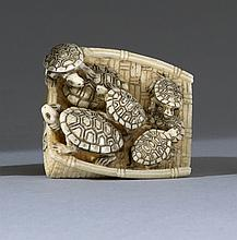 IVORY NETSUKE In the form of seven turtles resting on a winnowing basket. Signed. Length 1.5