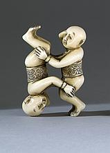 IVORY NETSUKE In the form of two infants. Signed