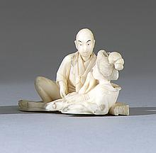 IVORY OKIMONO Depicting a man and woman in an intimate scene. Length 1.75