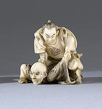 IVORY NETSUKE Depicting two wrestlers. Signed