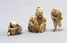 THREE IVORY NETSUKE Seated man with rooster, seated child with basket, and standing peasant figure. Not available for international...