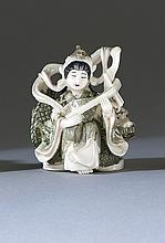 POLYCHROME IVORY NETSUKE Depicting a tennin and dragon. Signed. Height 2