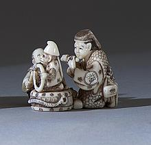 POLYCHROME IVORY NETSUKE Depicting a Sarumawashi entertainer with a flute player and monkey. Height 1.25