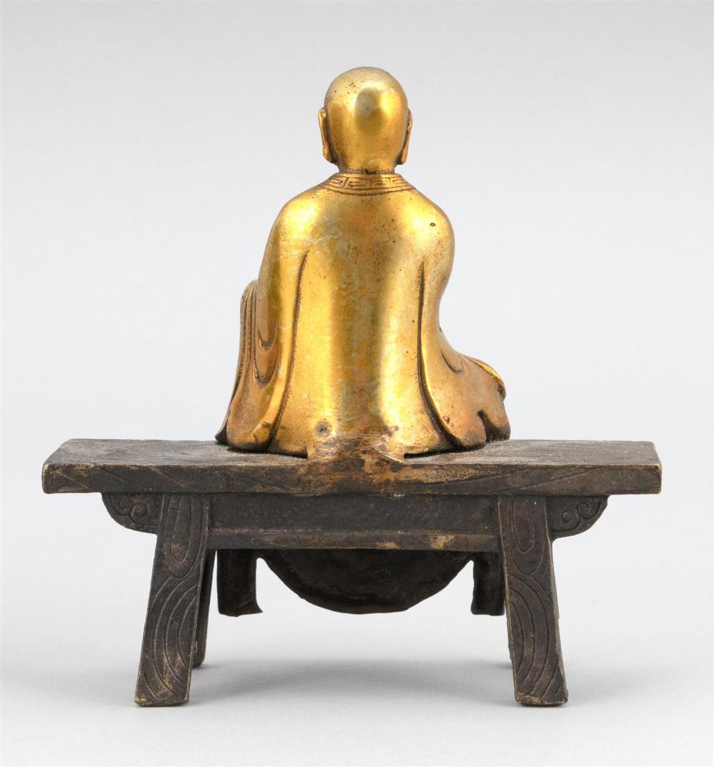 GILT BRONZE FIGURE OF BUDDHA Seated on an altar bench. Height 6