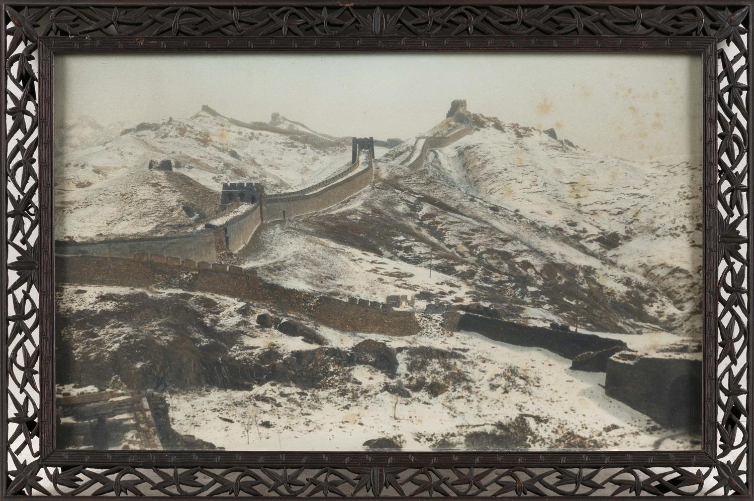 """CHINESE HAND-COLORED PHOTOGRAPH Depicts the Great Wall of China. Housed in a Chinese export carved wooden frame. Framed 11.5"""" x 17""""...."""
