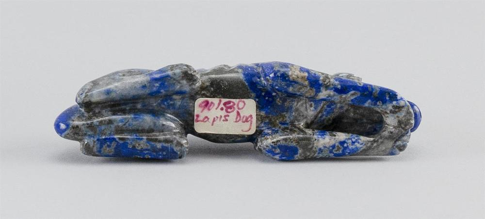 CHINESE LAPIS LAZULI CARVING OF A RECLINING DOG Rich blue coloring. Length 4