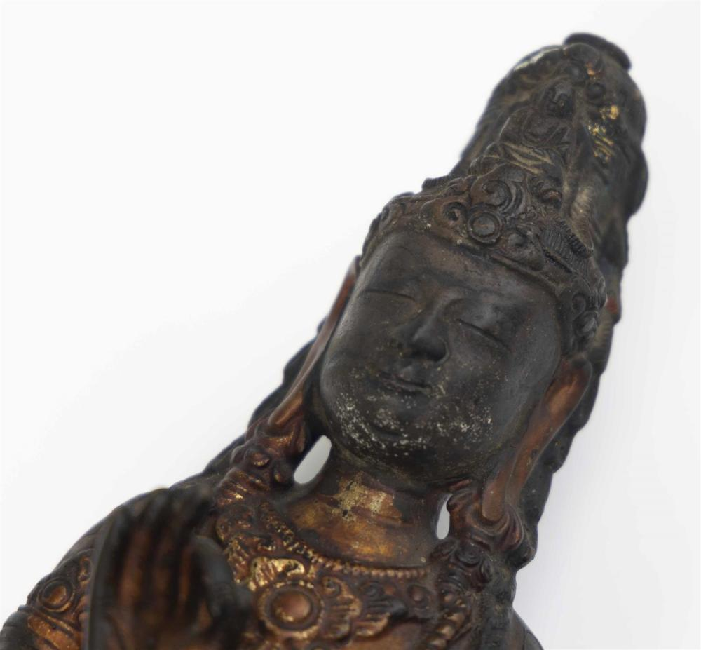 CHINESE BRONZE FIGURE OF A STANDING ACUOYE GUANYIN Made in two parts. Right hand raised and left hand cast down. Once attached to a...