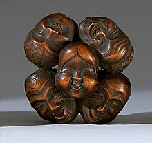 WOOD NETSUKE In the form of nine theatrical masks. Diameter 2