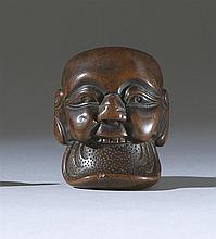 WOOD MASK NETSUKE In the form of a smiling man sticking out an enormous tongue. Length 2