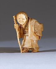 IVORY NETSUKE By Hogetsu. In the form of an elderly lady walking with a staff while holding prayer beads. Signed. Height 1.75