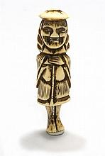BONE NETSUKE In the form of a Dutchman in standing position. Height 2.75