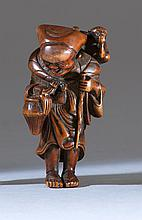 WOOD NETSUKE Depicting a sarumawashi entertainer with his monkey. Height 2.3
