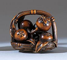 WOOD NETSUKE By Mitsuhiro. In the form of a basket of loquats, with relief carving of a fly. Length 2