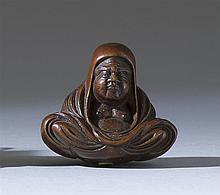 WOOD NETSUKE By Shumin. In the form of Daruma seated while wrapped in his robes. Signed. Height 1.3