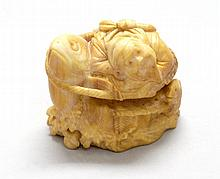 IVORY NETSUKE Depicting Ebisu with a carp and a fishing basket. Signed. Length 2