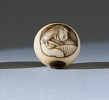 IVORY OJIME By Kokusai. In ball form with depicting of Okame in a circular cartouche. Signed with Koku seal. Diameter .75