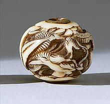 IVORY OJIME In ball form with relief dragon design. Diameter .75