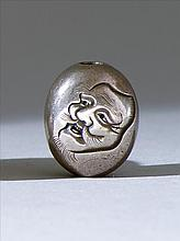 SILVER OJIME By Kosai. In seed form with engraved design of an Okina mask. Length .7