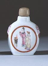 PORCELAIN SNUFF BOTTLE In flattened ovoid form. With famille rose mask and mock ring handles and figural cartouches on a white groun...