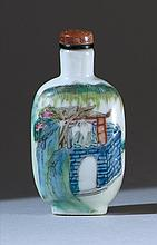 PORCELAIN SNUFF BOTTLE In spade shape with figural landscape design. Four-character Qianlong mark on base. Height 2.4