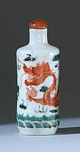 PORCELAIN SNUFF BOTTLE In cylinder form with rust-red and green dragon design. Four-character Daoguang mark on base. Height 3