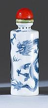 PORCELAIN SNUFF BOTTLE With blue glaze dragon design on cylindrical body. Four-character Qianlong mark on base. Height 2.8