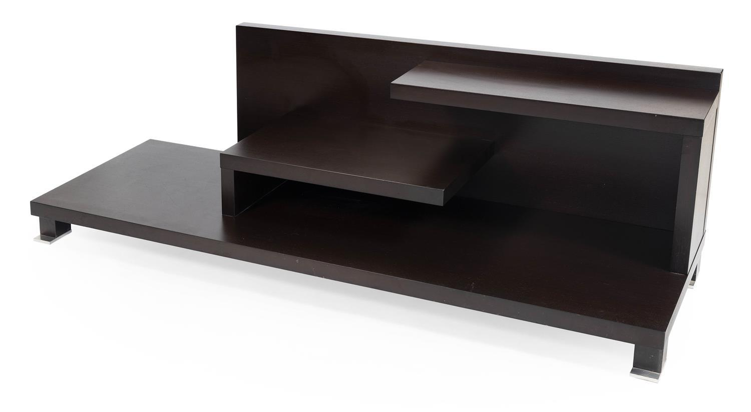 ROCHE BOBOIS EBONIZED WOOD LOW SHELF Two cantilevered shelves above a wide base supported by four nickel-capped feet. Unsigned. Heig...