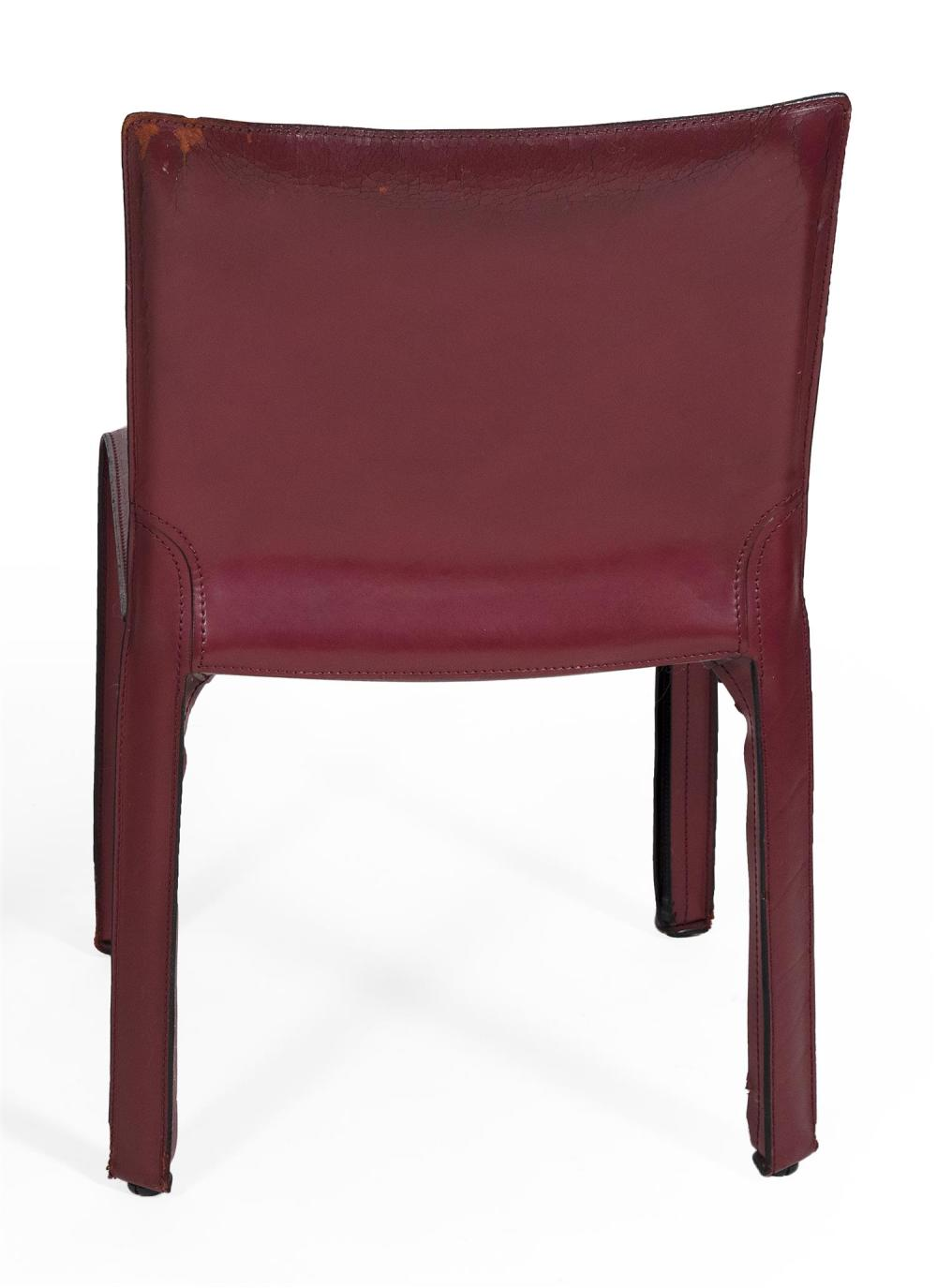 CASSINA T-4 CAB CHAIR BY MARIO BELLINI Plastic and steel frame covered in a zippered bordeaux red saddle leather skin. Signed on und...