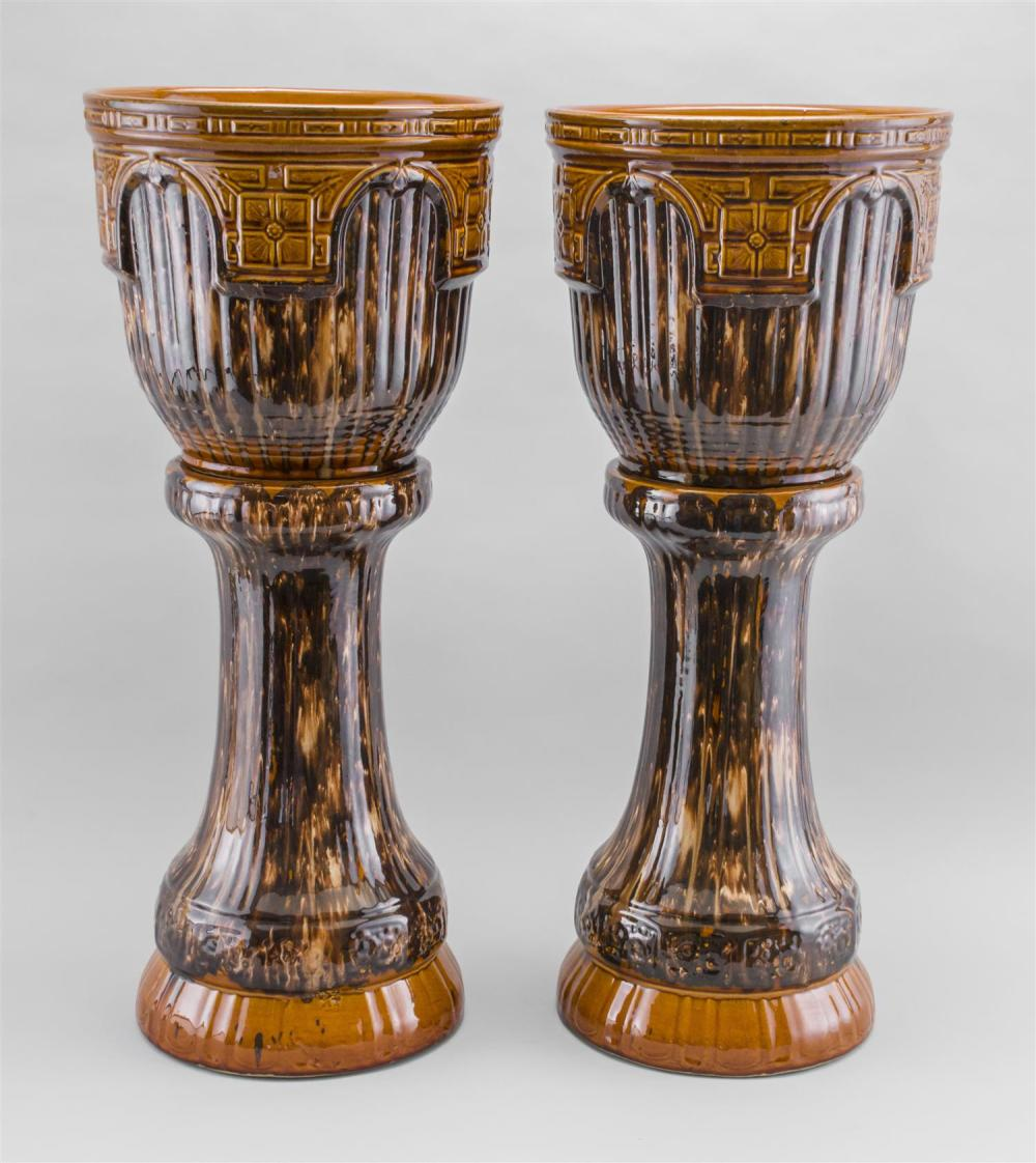 """PAIR OF AMERICAN ART POTTERY ROCKINGHAM GLAZED JARDINIÈRES ON STANDS Total heights 17.5""""."""