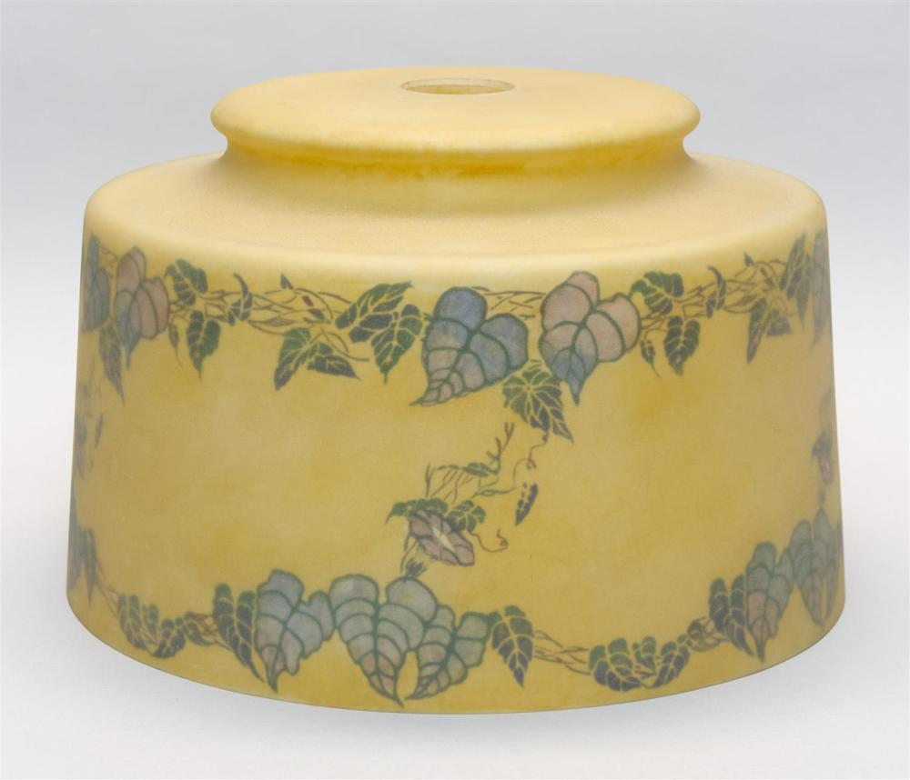 "REVERSE-DECORATED GLASS LAMPSHADE Trumpet vine design on an amber ground. Diameter 16""."