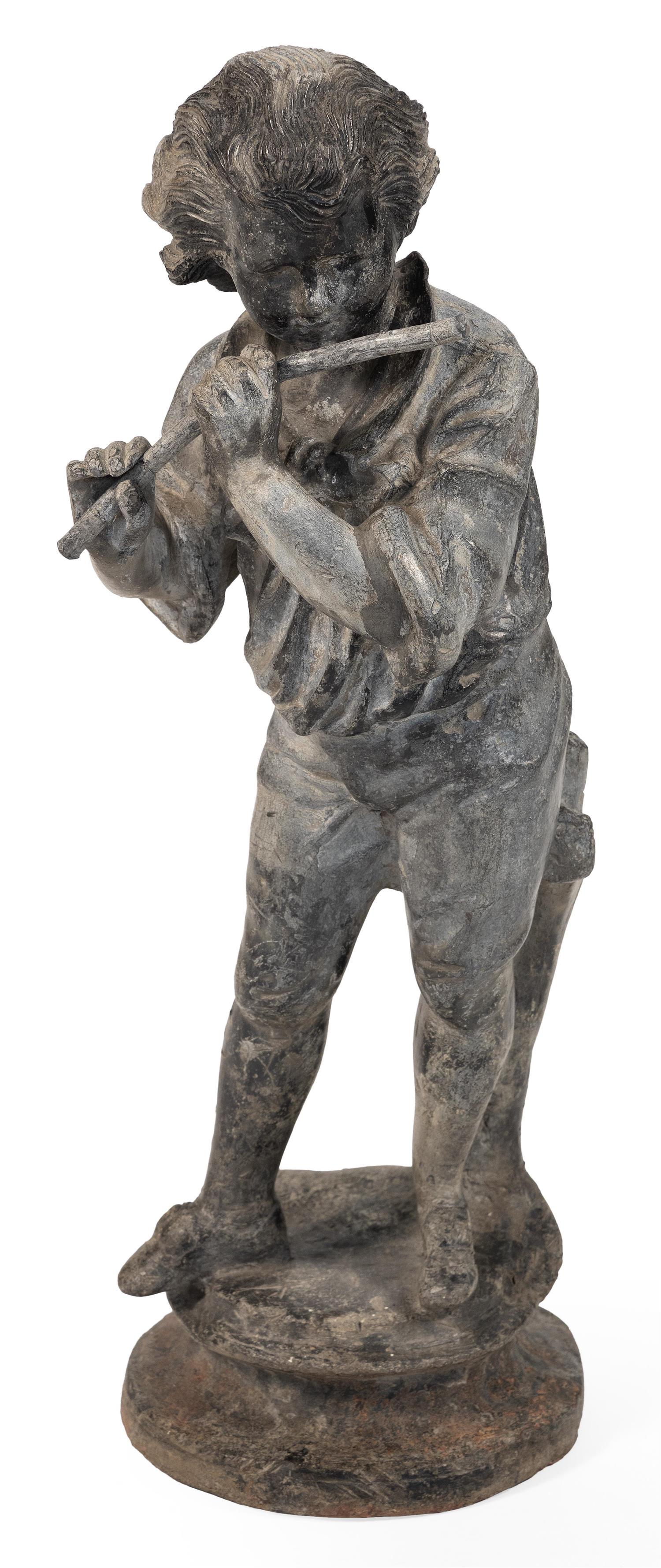 "LEAD GARDEN SCULPTURE OF A YOUNG BOY PLAYING THE FLUTE Unmarked. Height 25.5""."