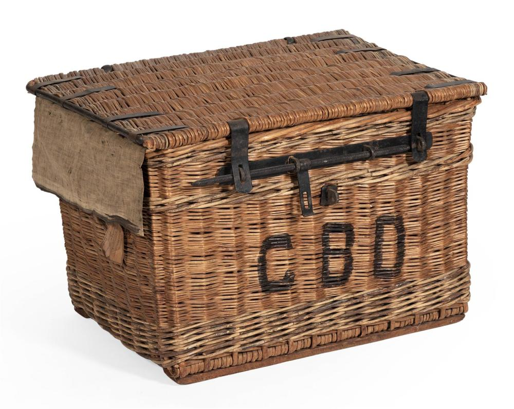 "UNUSUAL WICKER STORAGE TRUNK Front with ""C.B.D."" in black lettering. Metal hardware. Height 21"". Width 32"". Depth 22"". Provenance: A..."