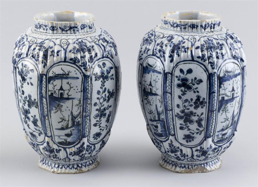 """PAIR OF DELFT VASES Octagonal, with paneled and ribbed moldings and blue and white decoration. Heights 9""""."""