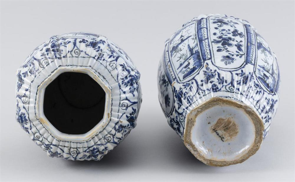 PAIR OF DELFT VASES Octagonal, with paneled and ribbed moldings and blue and white decoration. Heights 9