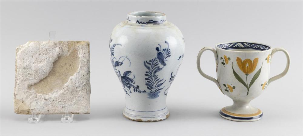 TWO PIECES OF ANTIQUE DELFT AND A SOFT-PASTE CUP A Delft vase with blue and white floral decoration, height 7.25