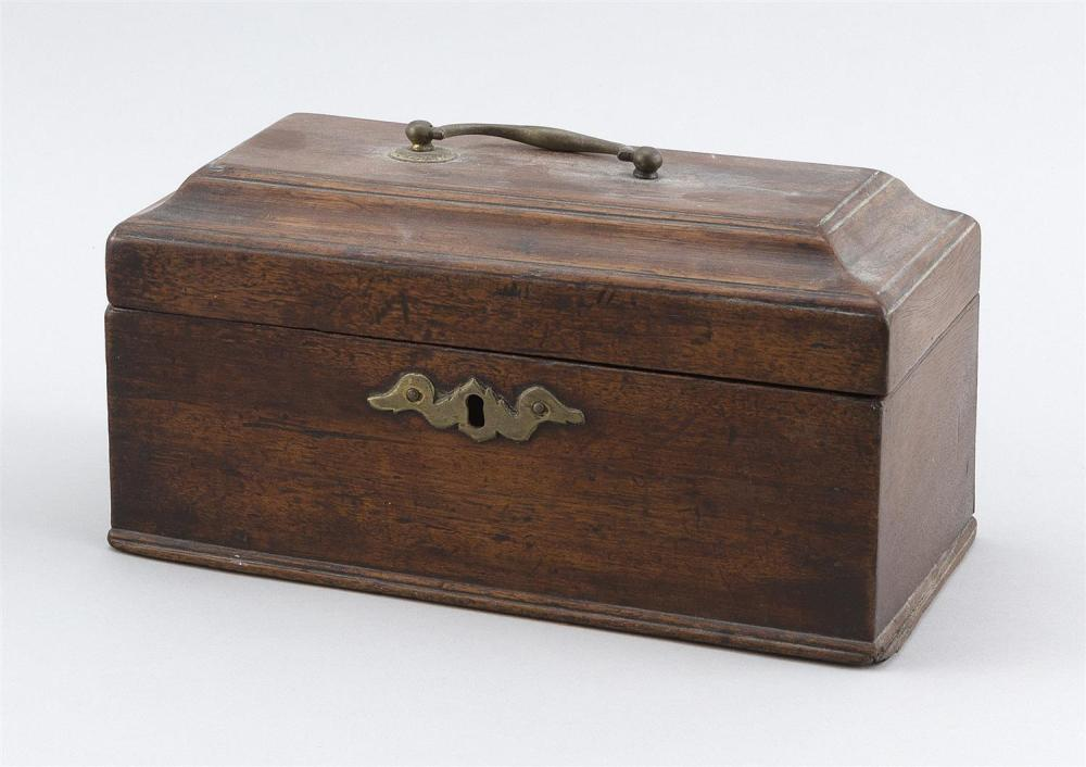 "ENGLISH TEA CADDY In walnut. Top with brass bail handle. Height 4.75"". Width 8.75"". Depth 5""."