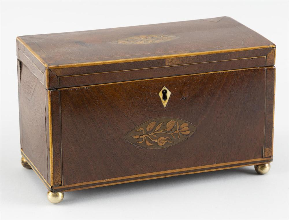 """ENGLISH TEA CADDY In mahogany, with fruitwood inlay and brass ball feet. Fitted interior. Height 5.25"""". Width 9"""". Depth 4.25""""."""