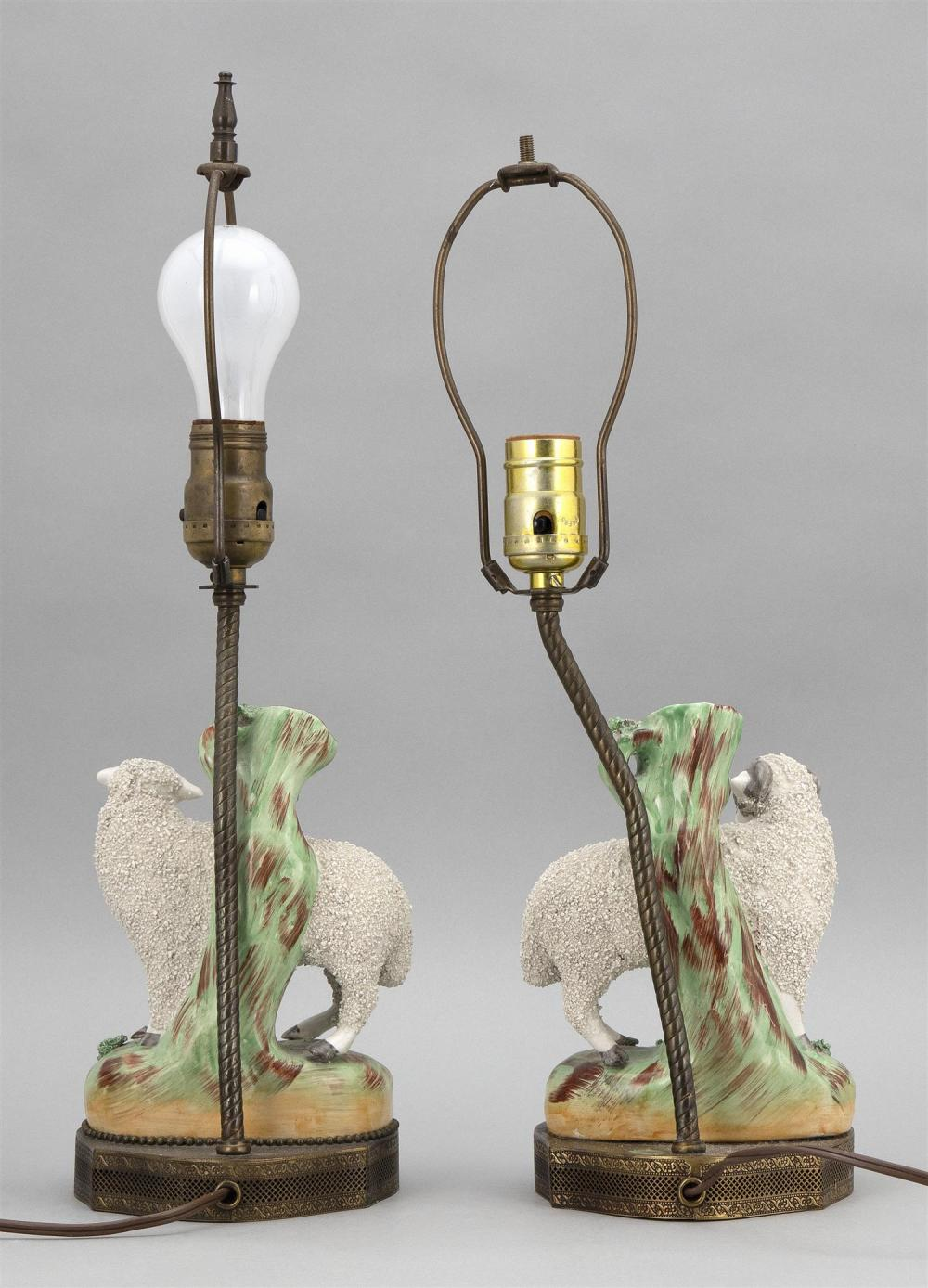 PAIR OF STAFFORDSHIRE SHEEP VASES A ewe and a ram, with tree stump behind. Mounted as lamps. Total heights 17.5