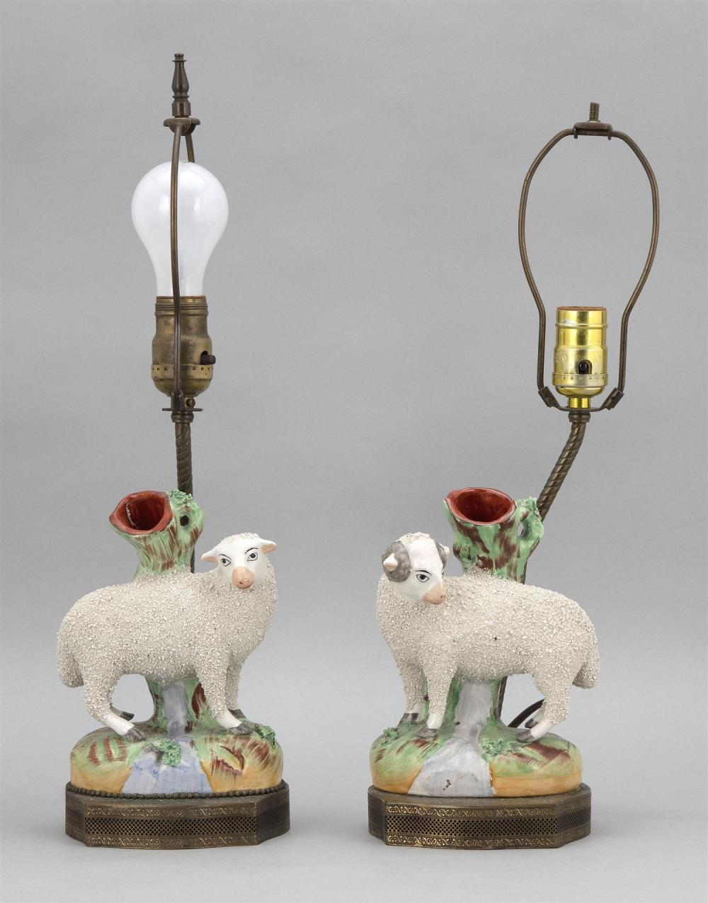"""PAIR OF STAFFORDSHIRE SHEEP VASES A ewe and a ram, with tree stump behind. Mounted as lamps. Total heights 17.5""""."""