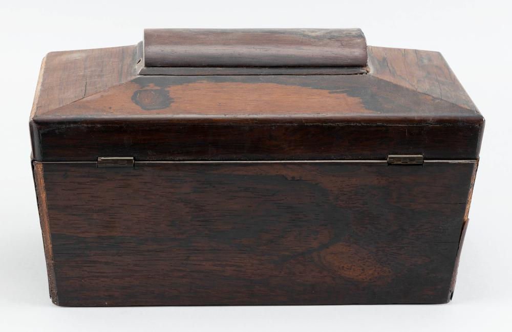ENGLISH TEA CADDY In rosewood veneer, showing some loss. Angled domed top. Interior fitted with later glass waste bowl. Height 7.25
