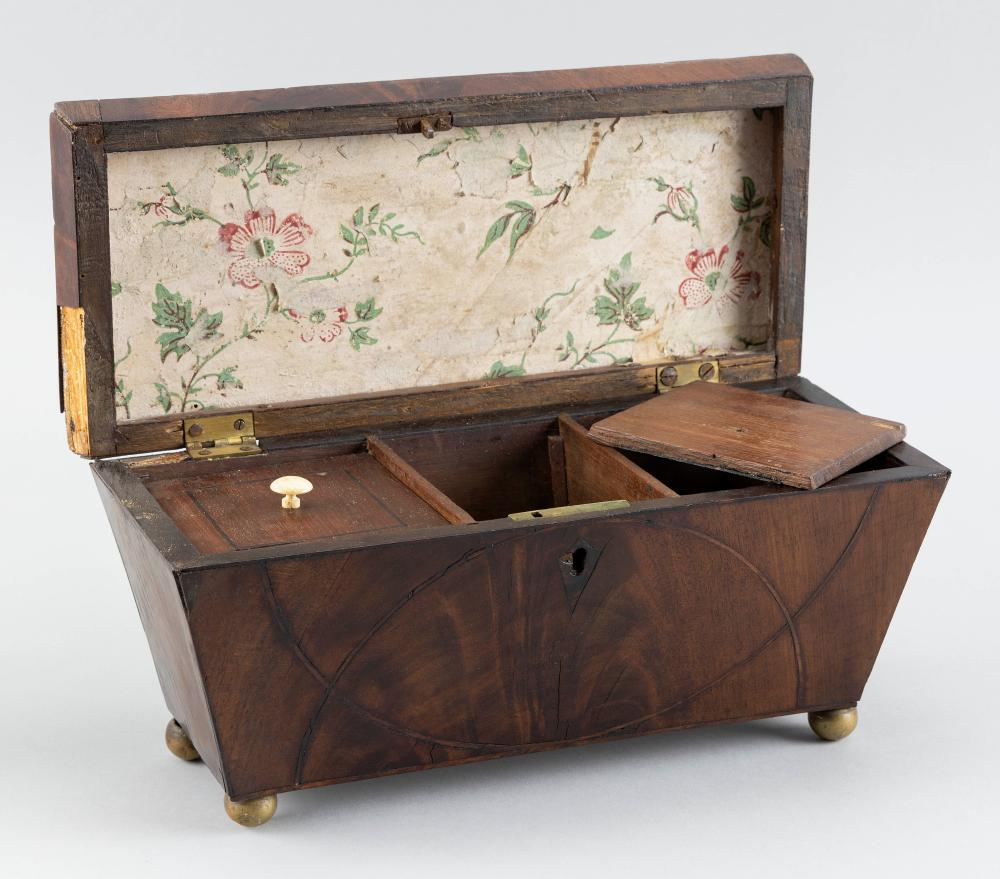 ENGLISH SARCOPHAGUS-FORM TEA CADDY In walnut veneer, with brass ball feet. Interior with three compartments; two lids missing. Heigh...