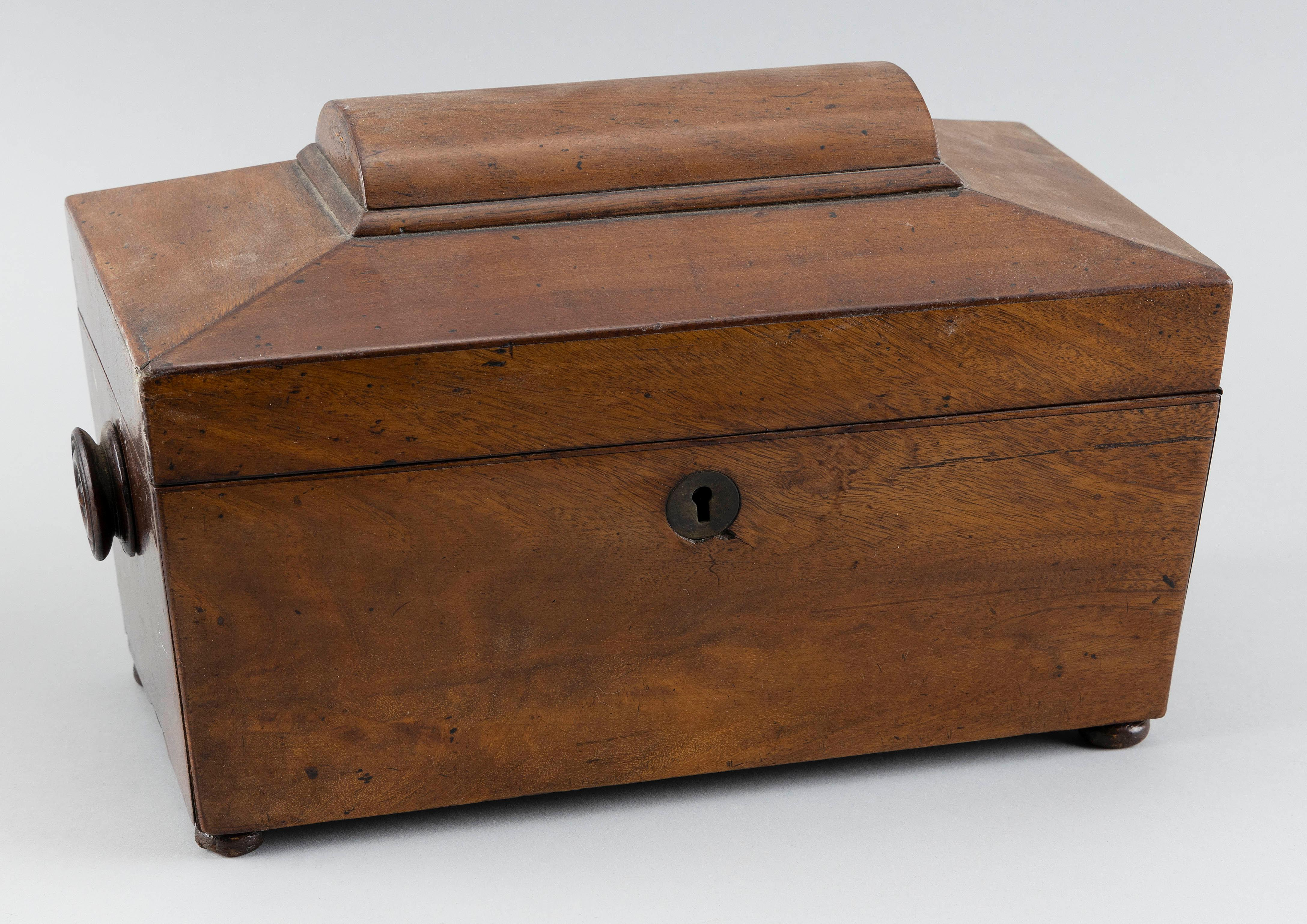 ENGLISH TEA CADDY In walnut veneer. Interior with later glass waste bowl and hinged lidded compartments. Turned wooden handles at si...