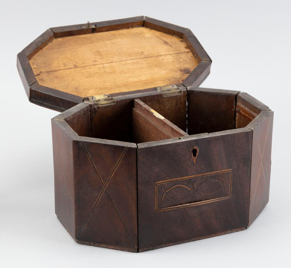 ENGLISH OCTAGONAL TEA CADDY In walnut veneer. Top with inlaid rectangular panel. Cross string inlay at corners. Interior two-part co...