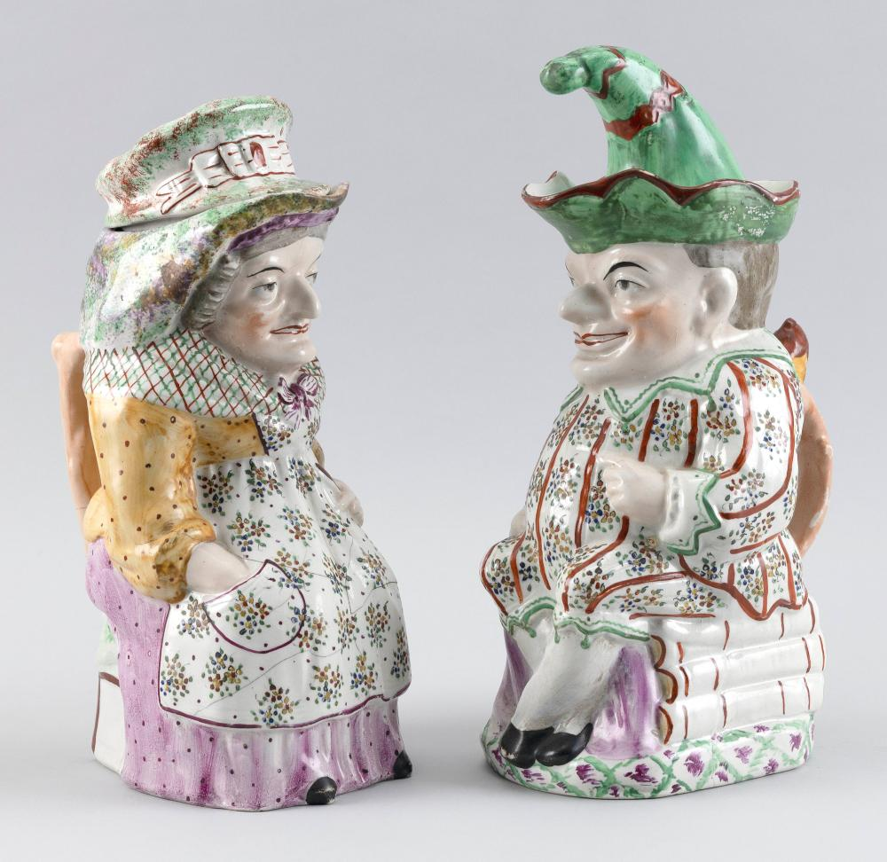 "PAIR OF ENGLISH STAFFORDSHIRE PUNCH & JUDY COVERED TOBY JUGS Late 19th Century, Heights 12"". Provenance:"