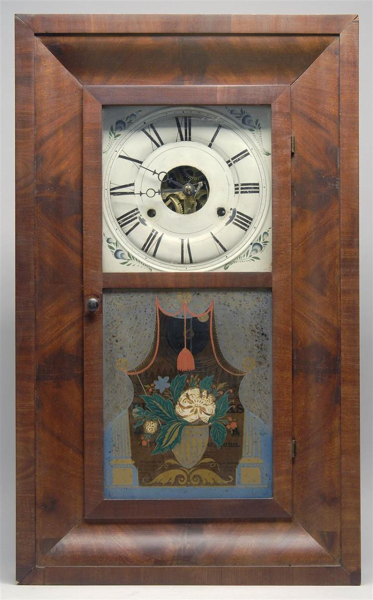 ANTIQUE SETH THOMAS OGEE SHELF CLOCK In mahogany veneers. Lower reverse-painted glass tablet depicts flowers and drapes with tassels...
