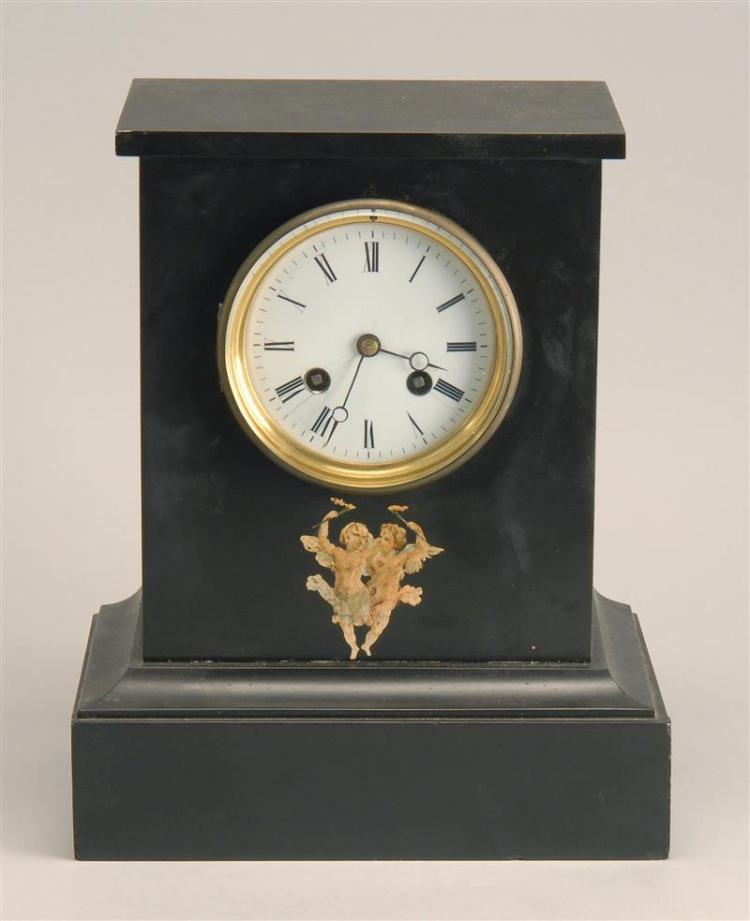 """FRENCH SLATE-CASED CLOCK With circular French movement. Enamel dial with Roman numerals. Découpage cherubs on front. Height 11""""."""
